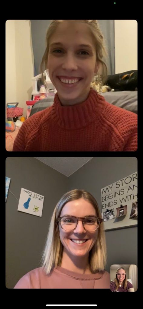 A screenshot of two women on a video chat. On the top, a woman is wearing an orange sweater. On the bottom, a woman has glasses and is wearing a pink shirt.